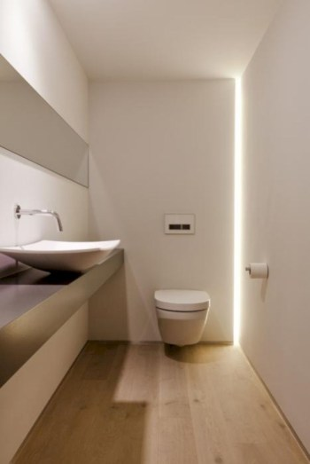 Nice and minimalist bathroom with the glass wall with a concrete 16