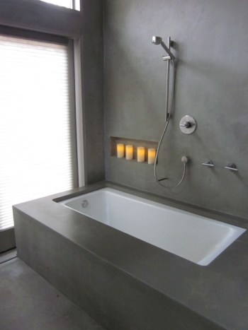 Nice and minimalist bathroom with the glass wall with a concrete 19