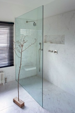 Nice and minimalist bathroom with the glass wall with a concrete 27