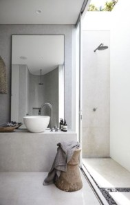 Nice and minimalist bathroom with the glass wall with a concrete 31
