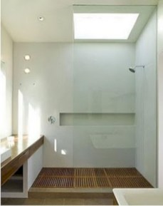 Nice and minimalist bathroom with the glass wall with a concrete 32