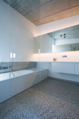 Nice and minimalist bathroom with the glass wall with a concrete 33