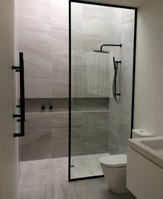 Nice and minimalist bathroom with the glass wall with a concrete 34