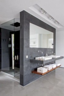 Nice and minimalist bathroom with the glass wall with a concrete 38