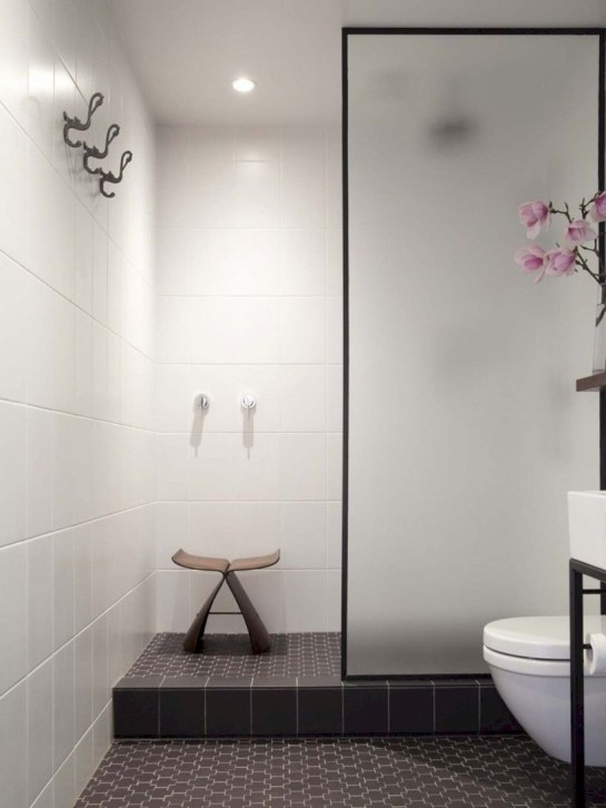 Nice and minimalist bathroom with the glass wall with a concrete 39