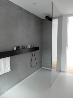 Nice and minimalist bathroom with the glass wall with a concrete 40