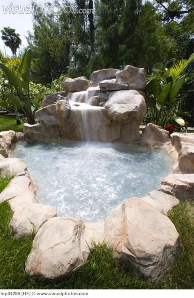 Pool waterfalls ideas for your outdoor space 06