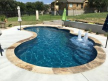 Pool waterfalls ideas for your outdoor space 07