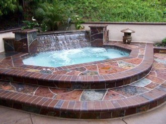 Pool waterfalls ideas for your outdoor space 10