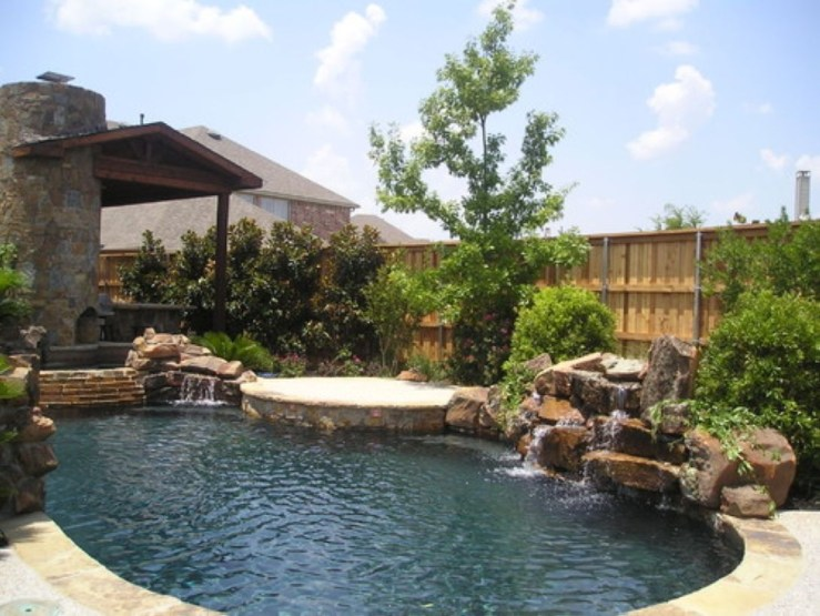 Pool waterfalls ideas for your outdoor space 11