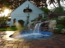 Pool waterfalls ideas for your outdoor space 13