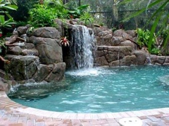 Pool waterfalls ideas for your outdoor space 14