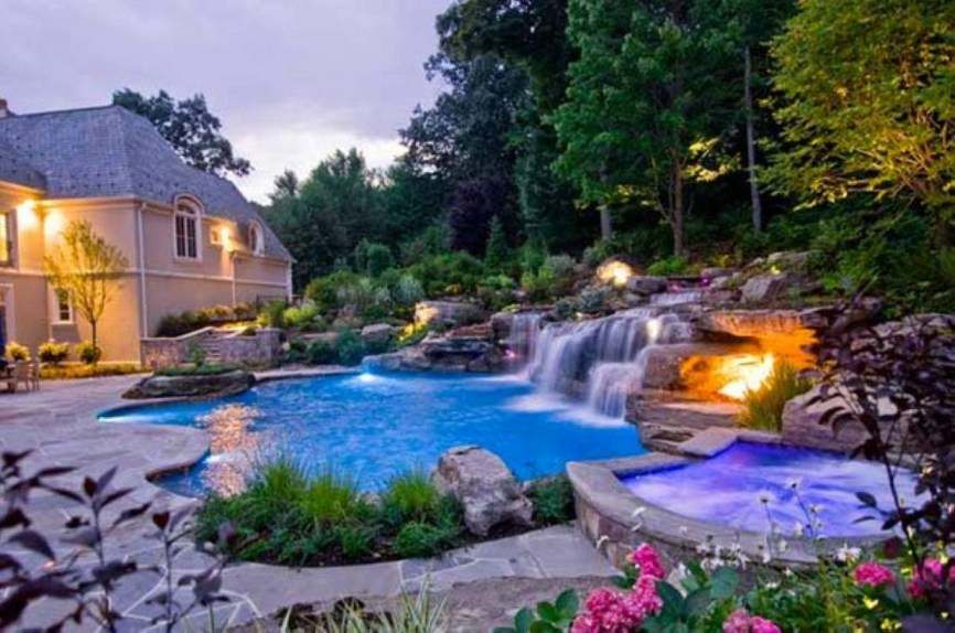 Pool waterfalls ideas for your outdoor space 18