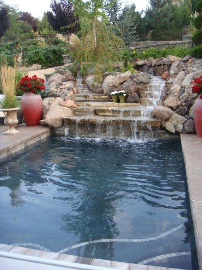 Pool waterfalls ideas for your outdoor space 20