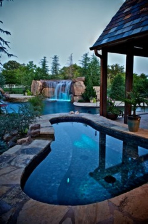 Pool waterfalls ideas for your outdoor space 21