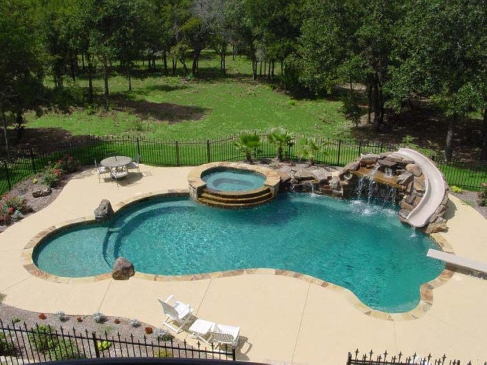 Pool waterfalls ideas for your outdoor space 22