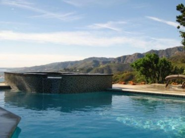 Pool waterfalls ideas for your outdoor space 30