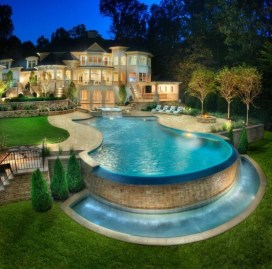 Pool waterfalls ideas for your outdoor space 33