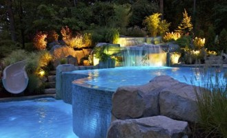 Pool waterfalls ideas for your outdoor space 37