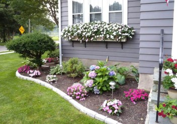 Pretty-floral-border-with-window-boxes-makes-for-a-nice-front-yard-landscaping-garden-idea