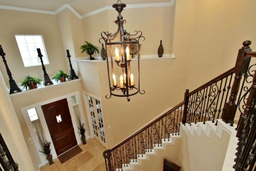 Ways to decorate with chandelier over the stairs 09