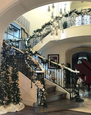 Ways to decorate with chandelier over the stairs 13