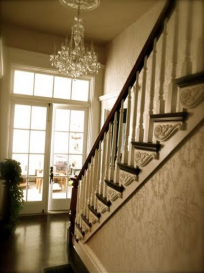 Ways to decorate with chandelier over the stairs 30