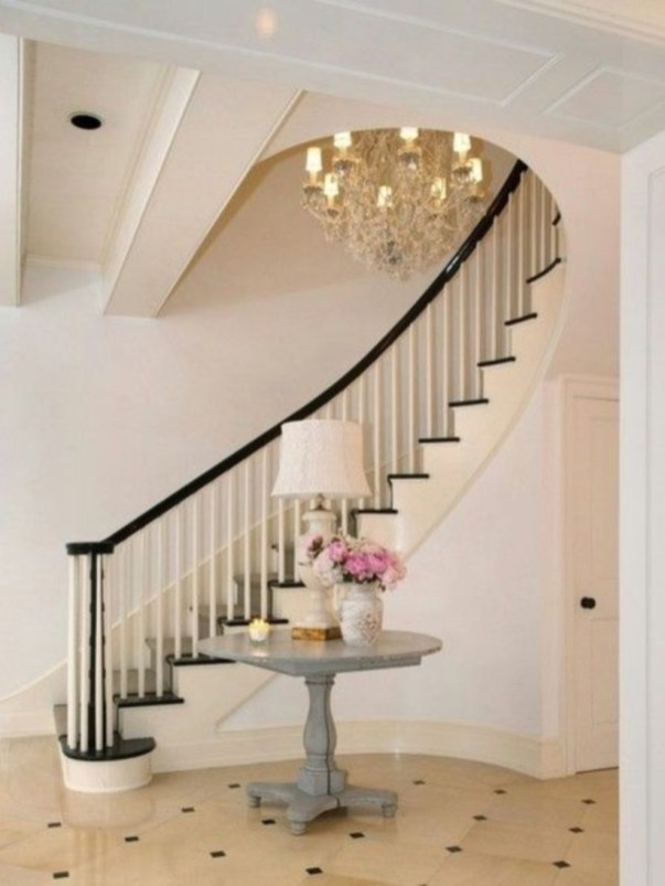 Ways to decorate with chandelier over the stairs 32