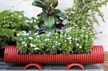 Garden-junk-creative-ideas-old-water-drain-flower-planter
