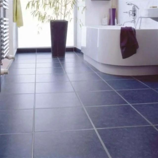 Bathroom with navy floor tiles