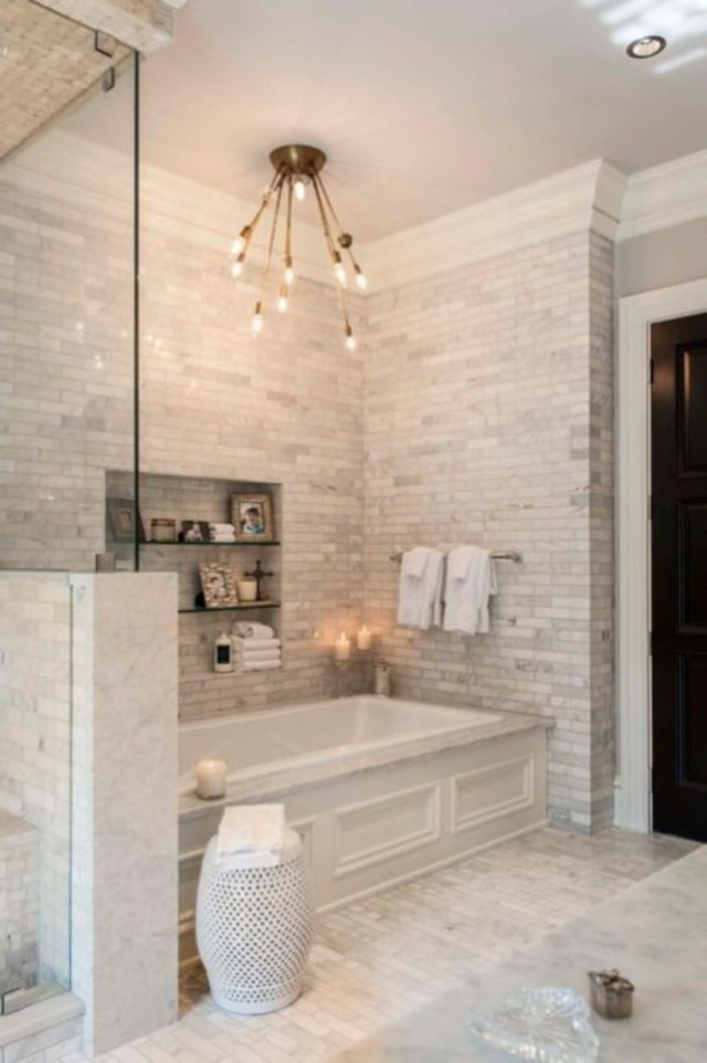 Farmhouse bathroom with freestanding vanity, cement tile and painted brick wall