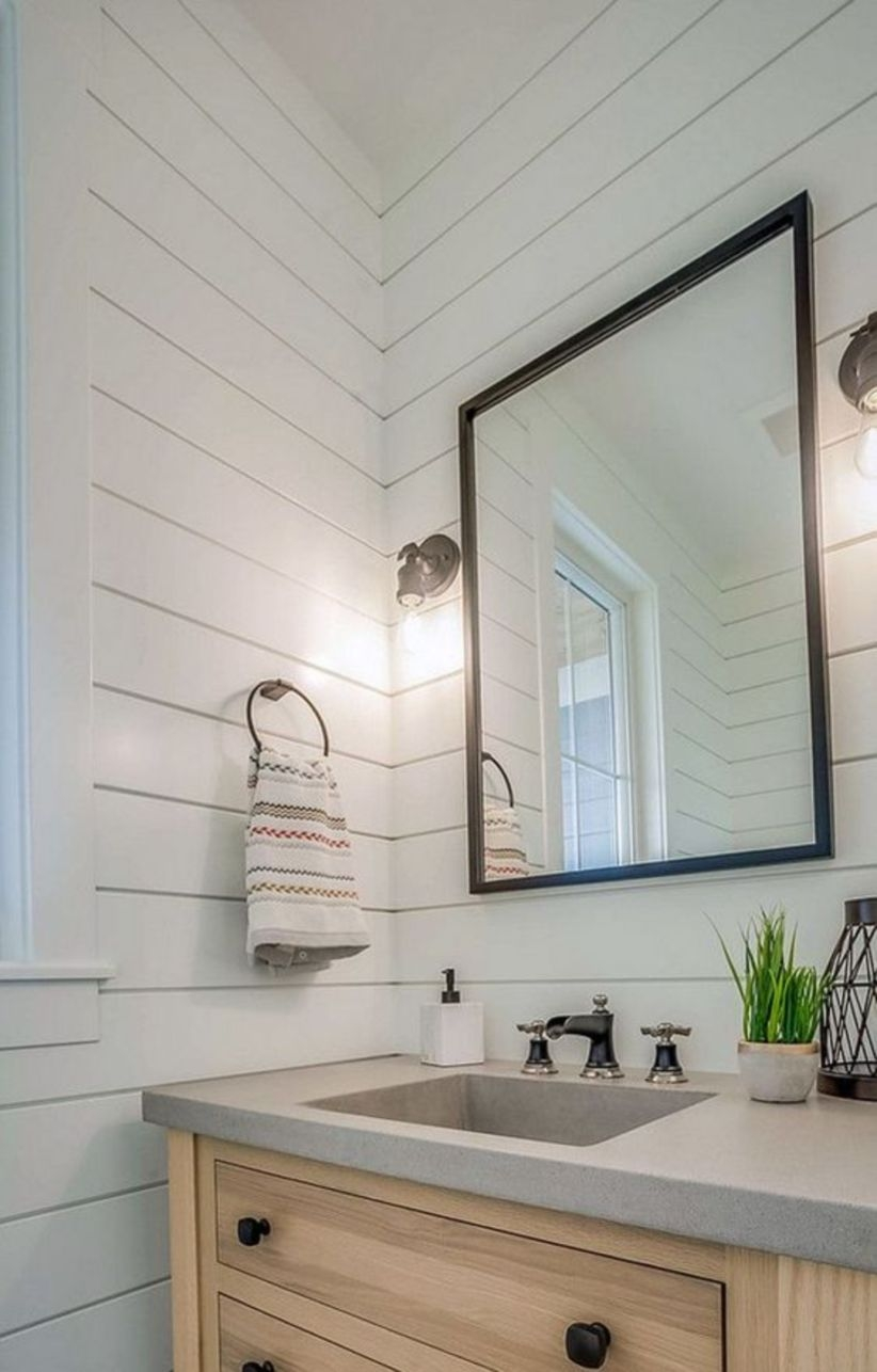 Farmhouse bathroom shiplap paneling white oak vanity concrete countertop with integrated sink and metal mirror