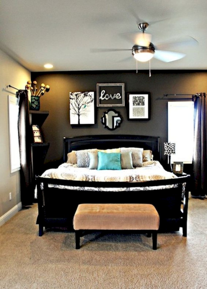 Master bedroom with dark grey accent wall