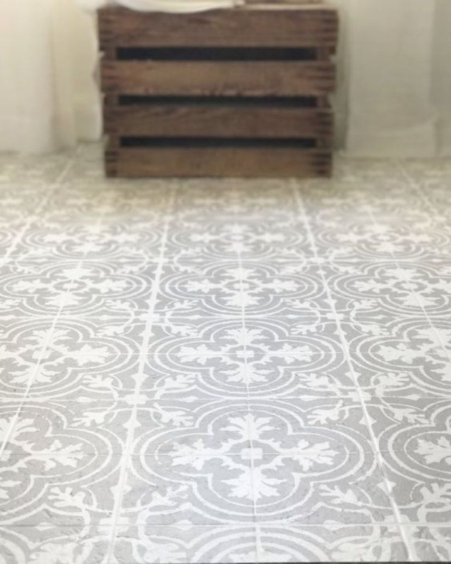 Paint your linoleum or tile floors to look like patterned cement