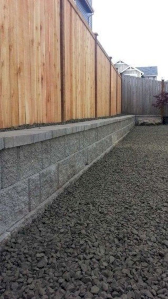 Wooden privacy fence with a cinder block wall