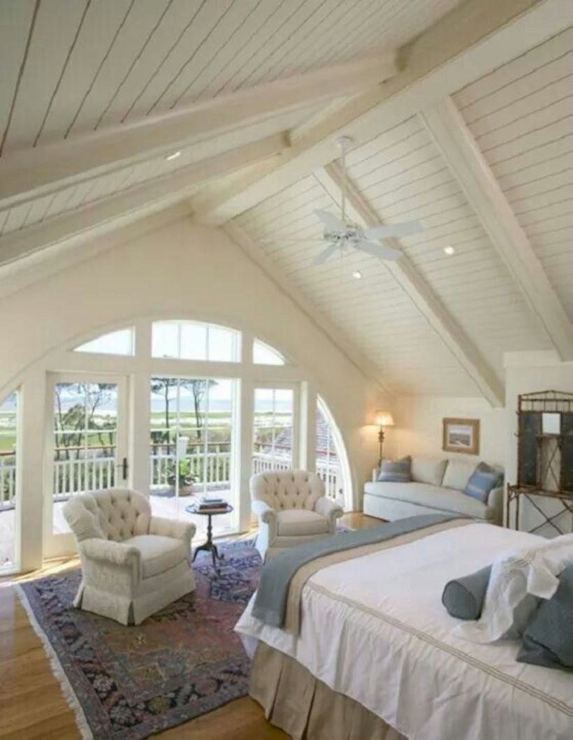 A country bedroom with the a frame ceiling