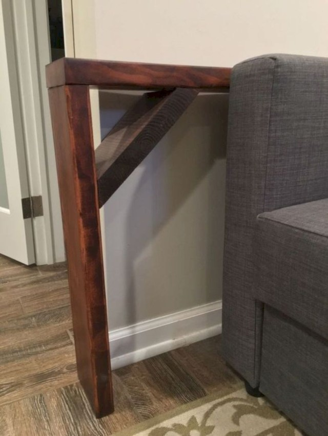 Behind the sofa table shelf