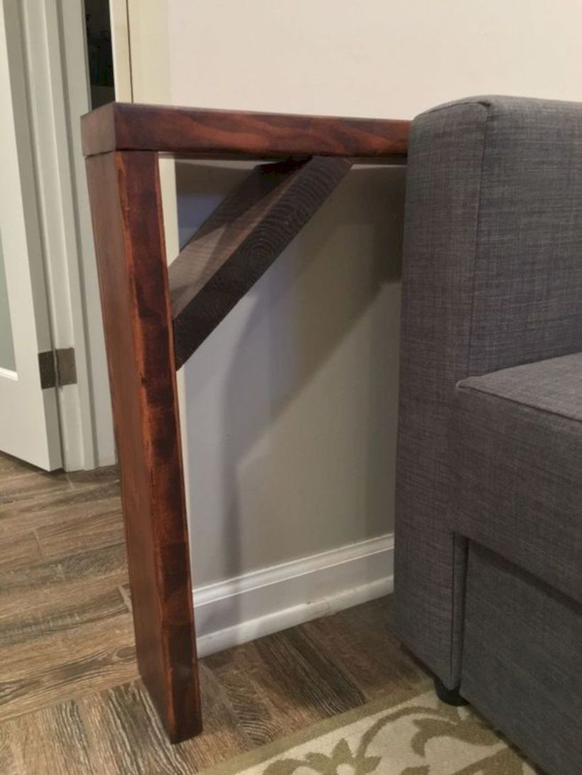Behind the sofa table shelf
