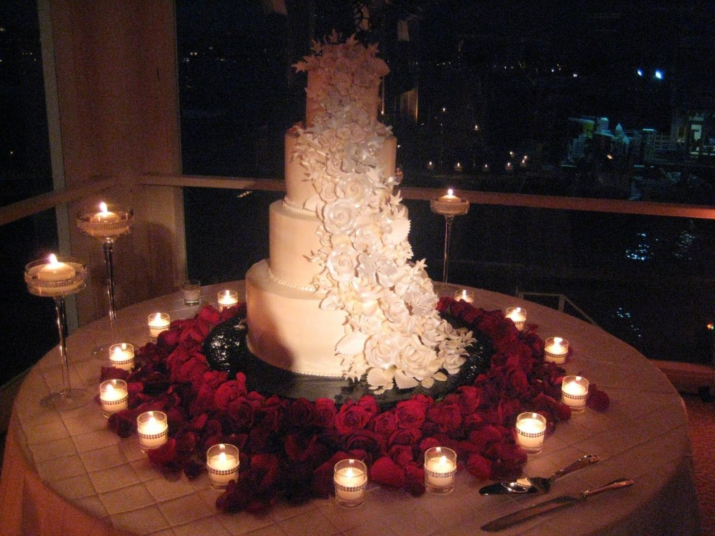 4. red roses, candle, and white cake for dinner