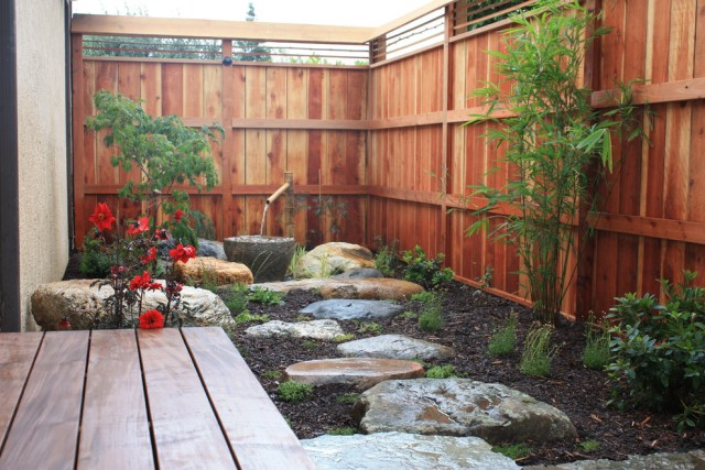 Japanese garden design with bamboo water feature