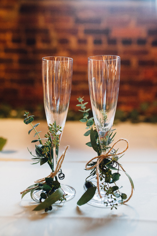 Bride and groom glasses with herbs