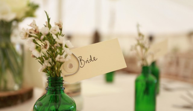 Table sign with greenery