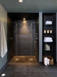 Elegant bathroom design with black walls 12