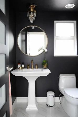 Elegant bathroom design with black walls 13