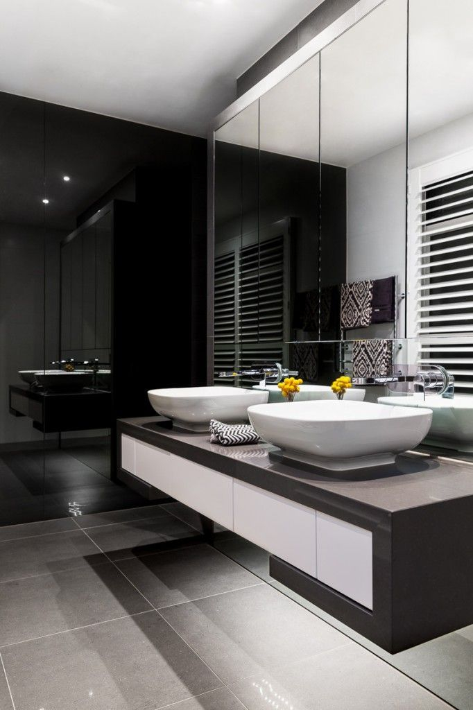 Elegant bathroom design with black walls 24