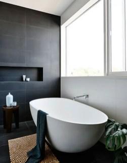 Elegant bathroom design with black walls 29
