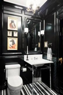 Elegant bathroom design with black walls 30