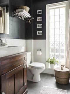 Elegant bathroom design with black walls 32