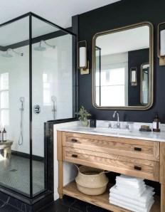 Elegant bathroom design with black walls 46