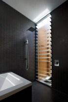 Elegant bathroom design with black walls 49